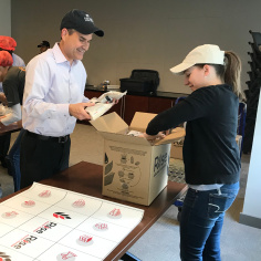 Employees assembled meals for Rise Against Hunger